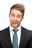 Frontal view of showing tongue businessman. Isolated on white. Concept of fun and carefree Royalty Free Stock Photos