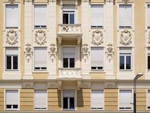 Fashionable facade in Merano near. Frontal view of a sophisticated facade in Merano Royalty Free Stock Photography