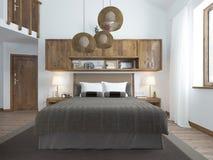 Frontale mening van het bed in de slaapkamer in de zolder Stock Foto's