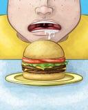 Fronte affamato con il cheeseburger Fotografie Stock Libere da Diritti