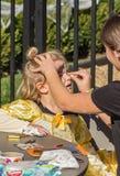Fronte che dipinge un bambino a Pumpkinfest Immagini Stock Libere da Diritti