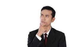 Fronte curioso dell'uomo d'affari, isolato su bianco Fotografie Stock Libere da Diritti