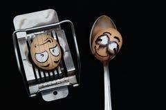 Fronte dell'uovo di due orrori sul nero Fotografie Stock Libere da Diritti
