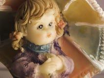 Fronte della bambola della porcellana con un ombrello Fotografia Stock