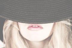 Fronte della donna del cappello Fotografie Stock