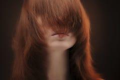 Fronte della femmina della copertura dei capelli Immagini Stock