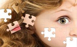 Fronte della ragazza di puzzle Fotografie Stock Libere da Diritti