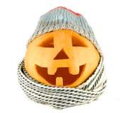 Fronte della zucca di Halloween con il cappello e la sciarpa Fotografia Stock