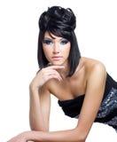 Fronte di bella donna con trucco blu Fotografie Stock