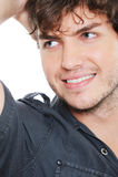 Fronte di bello uomo sorridente che osserva via Immagini Stock Libere da Diritti