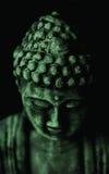 Fronte di Buddha nel verde Fotografia Stock Libera da Diritti