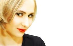 Fronte di giovane donna bionda con gli occhi verdi Fotografia Stock