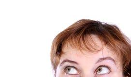 Fronte di giovane donna che osserva in su Fotografia Stock