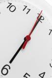 Fronte di orologio che mostra tempo che corre a sei Fotografia Stock