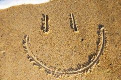 Fronte di smiley nella sabbia Fotografia Stock