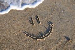 Fronte di smiley nella sabbia Fotografie Stock Libere da Diritti