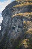 Fronte di Troll su una scogliera del Geirangerfjord Fotografia Stock