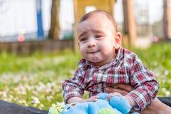 Fronte divertente dei 6 mesi svegli di bambino Fotografie Stock