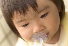 Fronte divertente del bambino dell'Asia Fotografia Stock