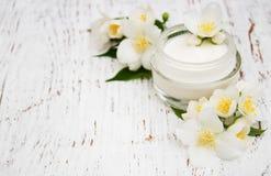 Fronte e idratante della crema per il corpo Fotografia Stock