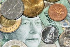 Fronte e monete dei soldi Fotografia Stock Libera da Diritti