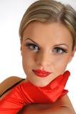 Fronte femminile di bellezza elegante con gli orli lucidi rossi Immagine Stock