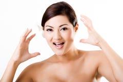 Fronte sorpreso rappresentazione asiatica attraente della femmina immagini stock