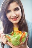 Fronte sorridente alto vicino della donna. Alimento di dieta. Fotografie Stock