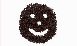 Fronte sorridente in chicchi di caffè Fotografia Stock Libera da Diritti