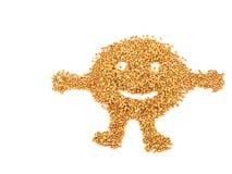 Fronte sorridente del grano saraceno isolato su fondo bianco fotografia stock libera da diritti