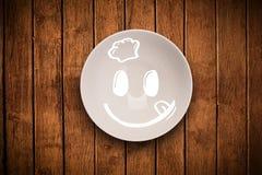 Fronte sorridente felice del fumetto sul piatto variopinto del piatto Immagini Stock