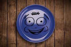 Fronte sorridente felice del fumetto sul piatto variopinto del piatto Immagini Stock Libere da Diritti