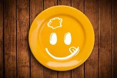 Fronte sorridente felice del fumetto sul piatto variopinto del piatto Fotografie Stock Libere da Diritti