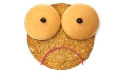 Fronte triste del biscotto Fotografia Stock