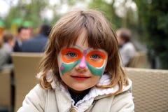 Fronte verniciato di una ragazza - farfalla Fotografie Stock Libere da Diritti