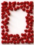 Frontera de corazones dispersados Foto de archivo libre de regalías