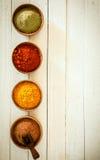 Frontera de especias coloridas Fotografía de archivo