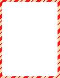 Frontera de la Navidad/bastón de caramelo Imagenes de archivo