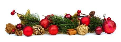 Frontera de la Navidad de ramas y de chucherías Foto de archivo