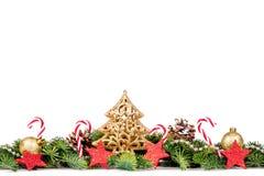 Frontera de la Navidad - ramas de árbol con las bolas, el caramelo y la decoración de oro Fotos de archivo