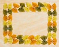 Frontera de las pastas de la corbata de lazo Foto de archivo libre de regalías