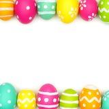 Frontera del doble del huevo de Pascua sobre blanco Foto de archivo libre de regalías