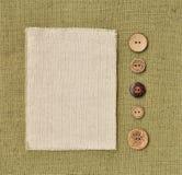 Frontera del marco de la lona con los botones de la ropa fotos de archivo libres de regalías