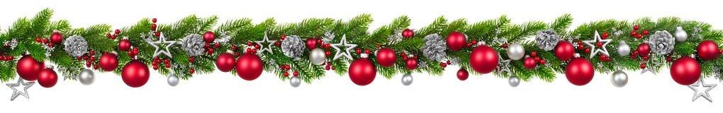 Frontera en blanco, guirnalda adornada colgante de la Navidad Fotografía de archivo libre de regalías