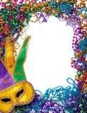 Frontera hecha de grano y de máscara del carnaval en blanco Fotos de archivo libres de regalías