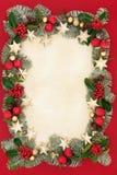 Frontera y decoraciones florales de la Navidad Foto de archivo