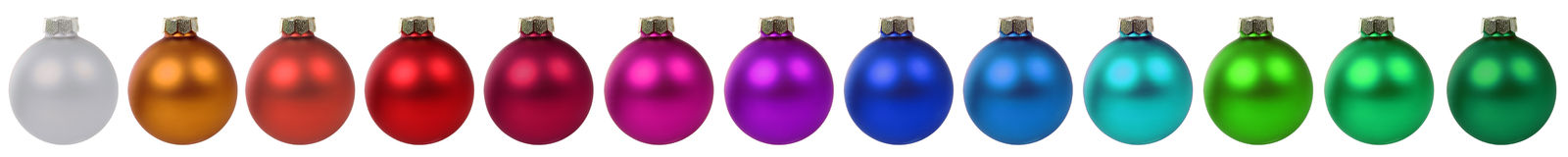 Frontière colorée de décoration de babioles de boules de Noël dans un isolant de rangée Image libre de droits