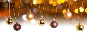 Frontière de carte de Noël avec des boules et l'effet de la lumière Images stock