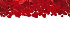 Frontière de coeurs de confettis Photo stock