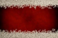 Frontière de flocon de neige de scintillement de Noël sur le rouge Images libres de droits